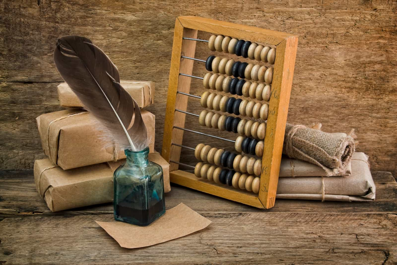 Old-Time Bookkeeping devices: abacus and ink pot + feather quill