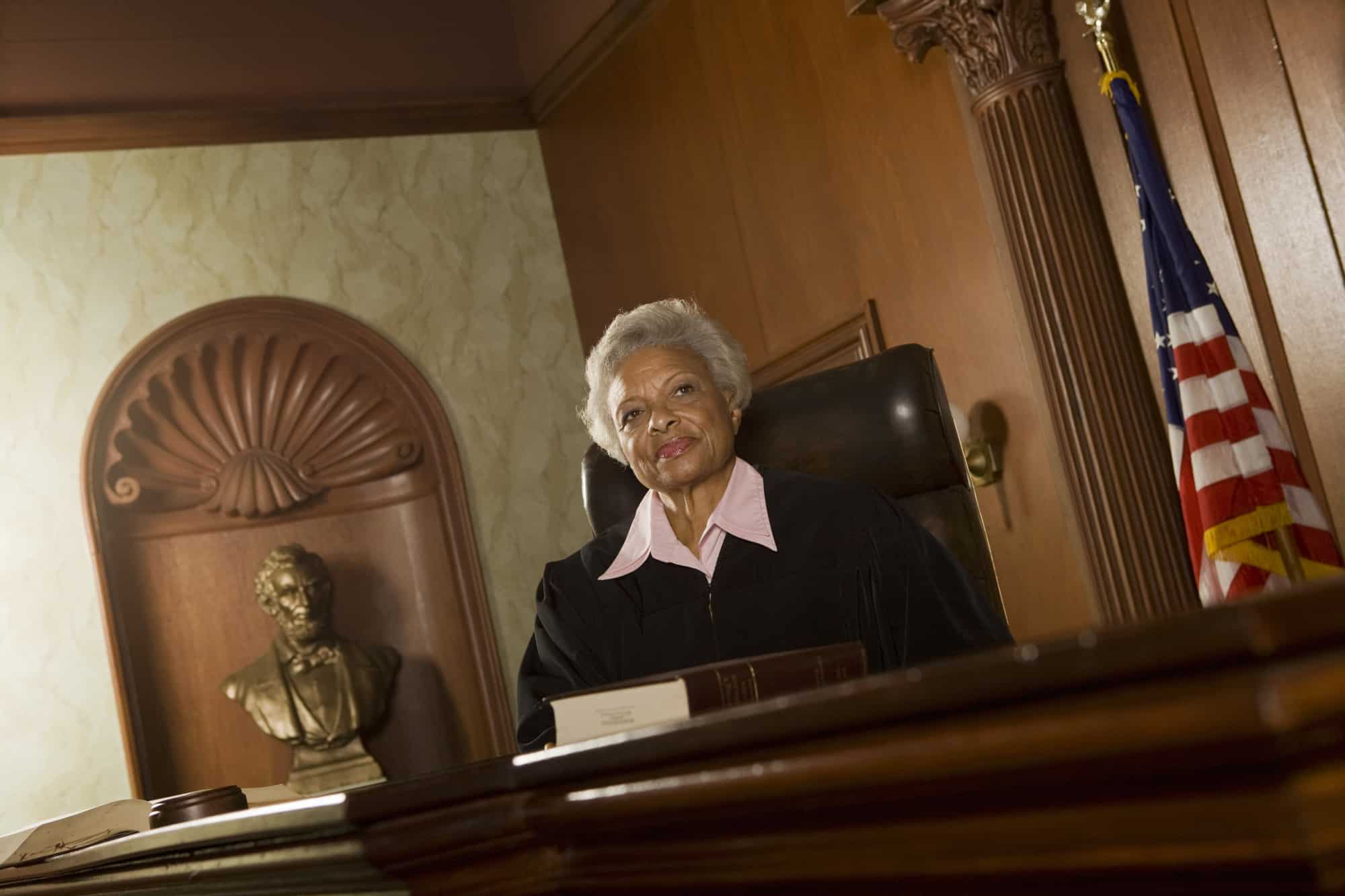 Black female judge presiding over a civil case due to DIY legal contracts.