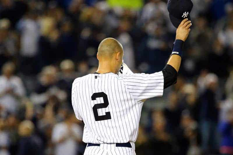 Derek Jeter standing on the field at Yankee Stadium wearing New York Yankees jersey #2 with back to camera