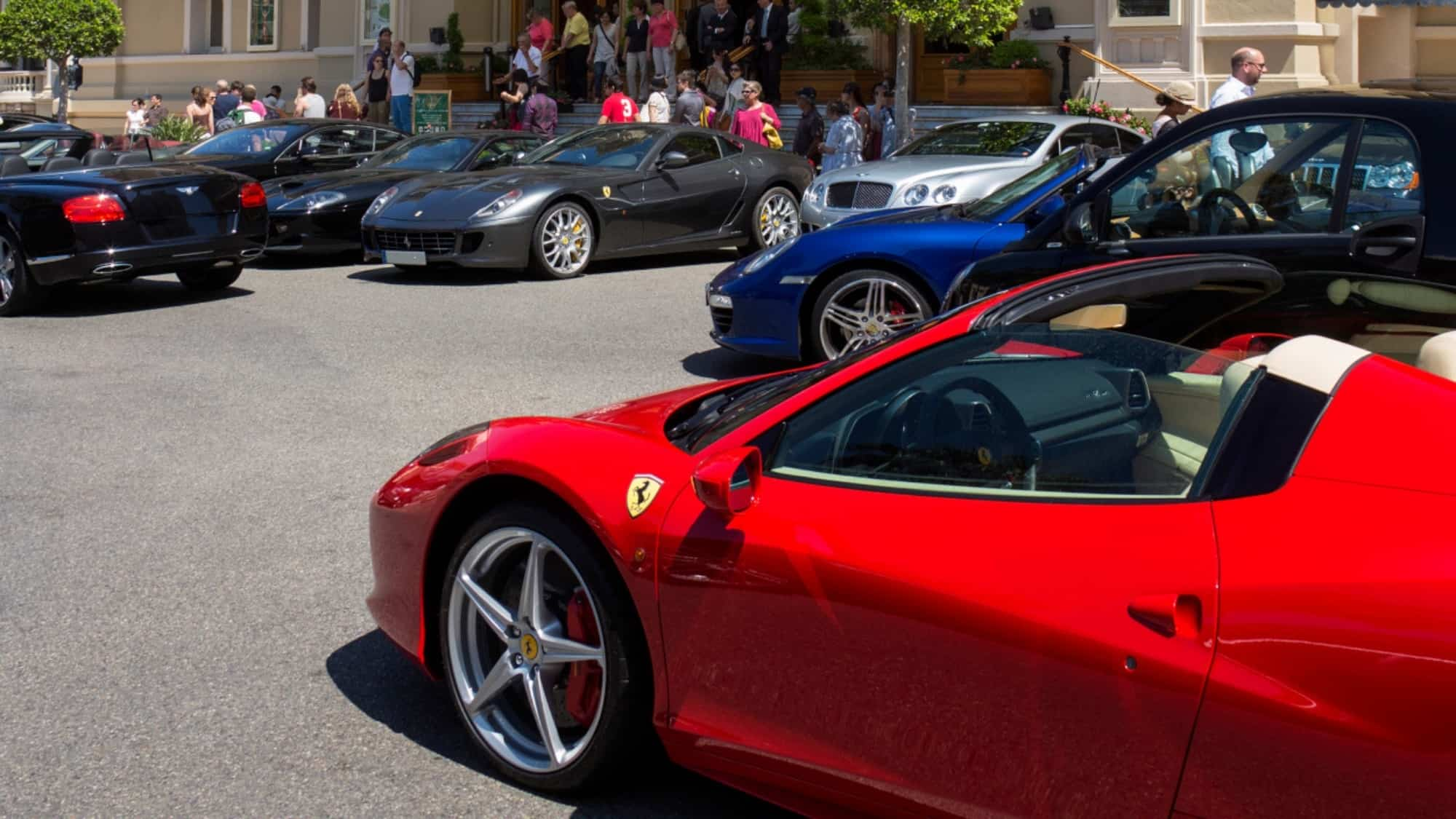 Expensive cars including Ferrari, Rolls Royce, and Bentley on display to the public