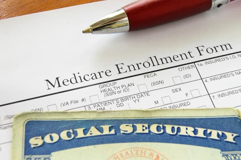Social Security card and Medicare enrollment form to claim as the self-employed health insurance deduction
